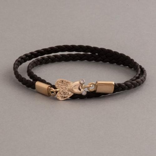 armband aus 18 Karat Gold mit Brillanten Fliege