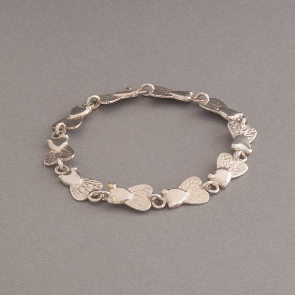 Armband aus Silber mit Fliegen