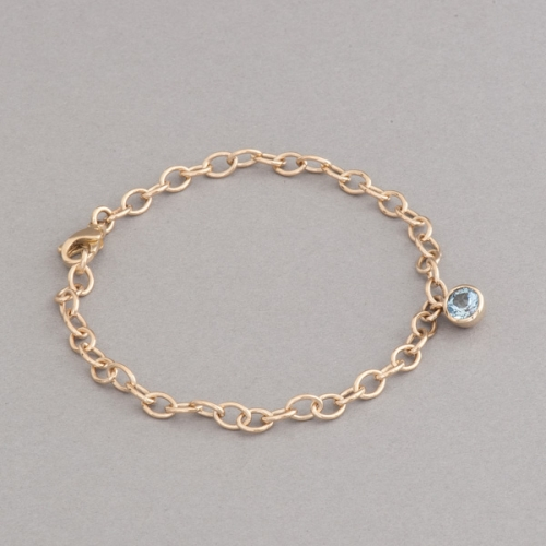 Armband aus 18 Karat Gold mit Aquamarin rund facettiert, Botho Nickel Hamburg