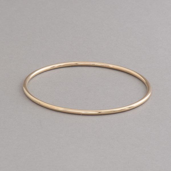 Armreif aus 18 Karat Gold rund 2,5 mm ohne Verschluss als Schlupfarmreif, Botho Nickel Schmuck Hamburg