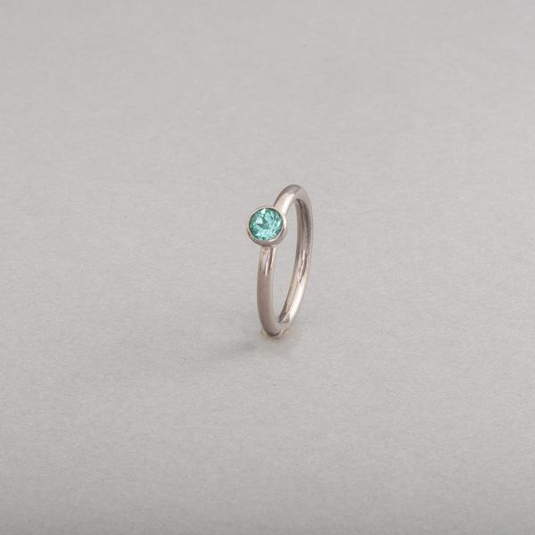 Ring aus Weissgold mit Paraiba Turmalin rund facettiert, Botho Nickel Schmuck Juwelier, Goldschmiede, Gemmologe und Diamantgutachter