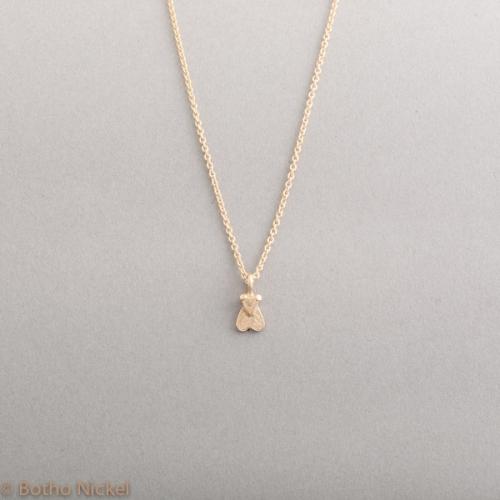 Kette aus 18 Karat Gold mit Fliege, Botho Nickel Schmuck Hamburg, Juwelier, Goldschmiede, Gemmologe und Diamantgutachter