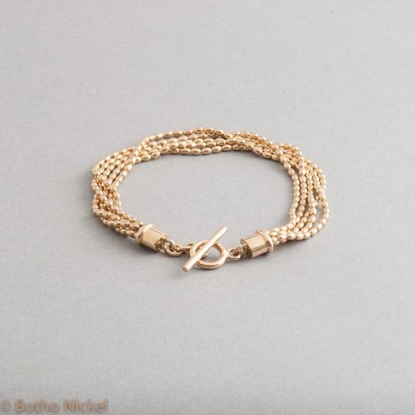 Armband aus 18 Karat Gold mit Knebelverschluss , Goldschmiede Botho Nickel Schmuck Hamburg, Juwelier, Goldschmiede, Gemmologe und Diamantgutachter