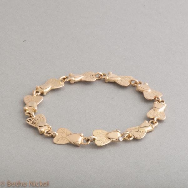 Armband aus 18 Karat Gold aus Botho Nickel Fliegen, Botho Nickel Schmuck Hamburg, Juwelier, Goldschmiede, Gemmologe und Diamantgutachter